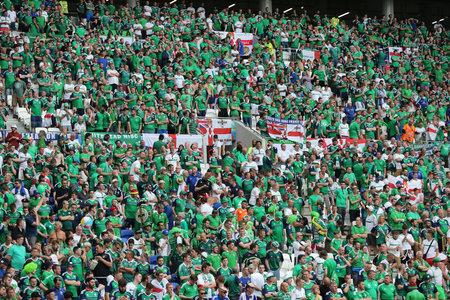 LYON, FRANCE - JUNE 16, 2016: Tribunes of Stade de Lyon stadium crowded with Northern Ireland fans during the UEFA EURO 2016 game Ukraine v Northern Ireland. Northern Ireland won 2-0