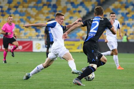 KYIV, UKRAINE - August 13, 2019: Viktor Tsygankov of FC Dynamo Kyiv (L) in action during the UEFA Champions League 3rd qualifying round game against Club Brugge at Olympic stadium in Kyiv Редакционное