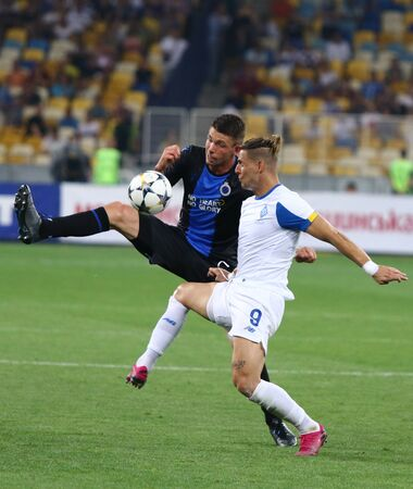 KYIV, UKRAINE - August 13, 2019: Brandon Mechele of Club Brugge (L) fights for a ball with Fran Sol of Dynamo Kyiv during their UEFA Champions League game at Olympic stadium in Kyiv