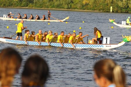 Kyiv, Ukraine - September 13, 2019: ICF Dragon Boat Club Crew World Championships 2019 on Dnipro river in Kyiv, Ukraine. D10 Senior Mixed 2000m Final, Team - Romi Canoe and Dragonboat Club (Hungary)
