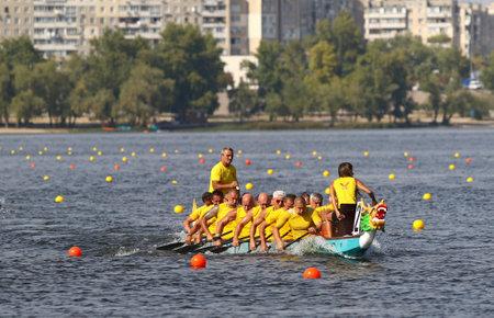 Kyiv, Ukraine - September 13, 2019: ICF Dragon Boat Club Crew World Championships 2019 on Dnipro river in Kyiv, Ukraine. D20 Senior Men 2000m Final, Team - Romi Canoe and Dragonboat Club (Hungary) 에디토리얼