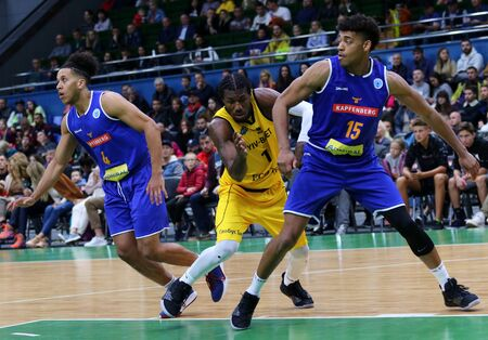 KYIV, UKRAINE - SEPTEMBER 20, 2019: D. Edwin of BC Kyiv Basket (Ð¡), K. Nathanial Gumbs and T. Schrittwieser of Kapfenberg Bulls fights for a rebound during their FIBA Basketball Champions League game