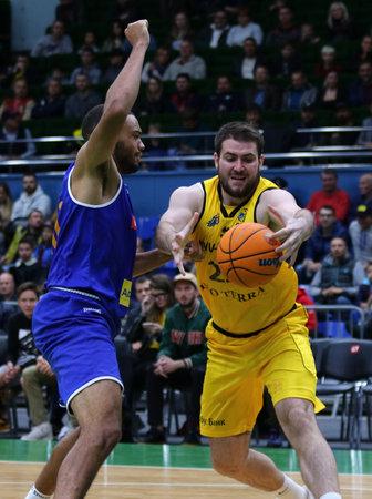 KYIV, UKRAINE - SEPTEMBER 20,2019: Viacheslav Petrov of BC Kyiv Basket (R) and Zachary Hogan Braxton of Kapfenberg Bulls in action during their FIBA Basketball Champions League Qualifiers game in Kyiv