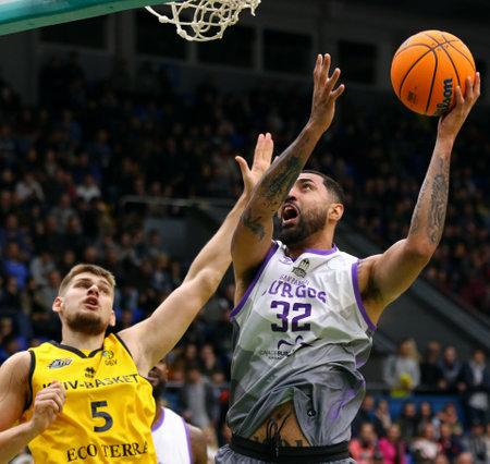 KYIV, UKRAINE - SEPTEMBER 26, 2019: Augusto Lima of San Pablo Burgos (R) attacks during the FIBA Basketball Champions League Qualifiers game BC Kyiv Basket v San Pablo Burgos in Kyiv