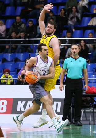 KYIV, UKRAINE - SEPTEMBER 26, 2019: Vitor Benite of San Pablo Burgos (L) and Viacheslav Petrov of BC Kyiv Basket in action during their FIBA Basketball Champions League Qualifiers game in Kyiv