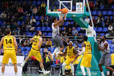 KYIV, UKRAINE - SEPTEMBER 26, 2019: FIBA Basketball Champions League Qualifiers game BC Kyiv Basket (in Yellow) v San Pablo Burgos (in Gray) at Palace of Sports in Kyiv. San Pablo Burgos won 86-83