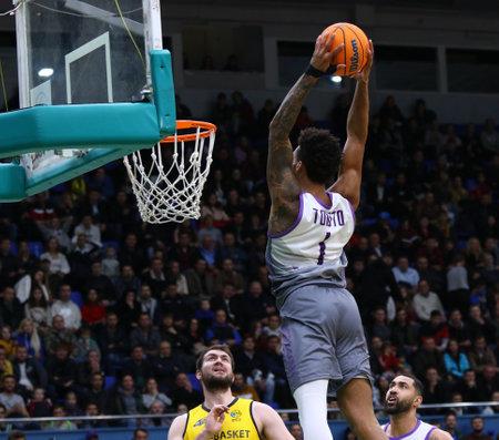 KYIV, UKRAINE - SEPTEMBER 26, 2019: JP Tokoto of San Pablo Burgos makes a slam dunk during the FIBA Basketball Champions League Qualifiers game BC Kyiv Basket v San Pablo Burgos in Kyiv Редакционное