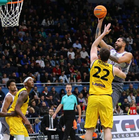 KYIV, UKRAINE - SEPTEMBER 26, 2019: Augusto Lima of San Pablo Burgos (R) throws the ball into basket during the FIBA Basketball Champions League Qualifiers game BC Kyiv Basket v San Pablo Burgos Редакционное