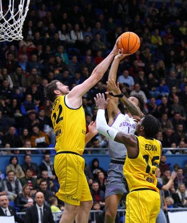 KYIV, UKRAINE - SEPTEMBER 26, 2019: Viacheslav Petrov of BC Kyiv Basket (L) makes a block shot to JP Tokoto of San Pablo Burgos in action during their FIBA Basketball Champions League Qualifiers game