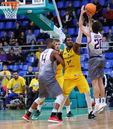 KYIV, UKRAINE - SEPTEMBER 26, 2019: Ferran Bassas of San Pablo Burgos (R) throws the ball during the FIBA Basketball Champions League Qualifiers game BC Kyiv Basket v San Pablo Burgos in Kyiv