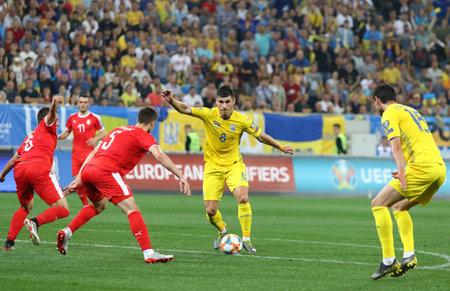 LVIV, UKRAINE - JUNE 7, 2019: Roman Yaremchuk of Ukraine (in Yellow) kicks a ball during the UEFA EURO 2020 Qualifying game against Serbia at Arena Lviv stadium. Ukraine won 5-0. Yaremchuk scored 1