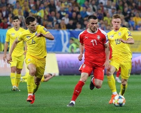 LVIV, UKRAINE - JUNE 7, 2019: Filip Kostic of Serbia (C) fights for a ball with Taras Stepanenko (L) and Viktor Tsygankov of Ukraine during their UEFA EURO 2020 Qualifying game at Arena Lviv stadium Редакционное