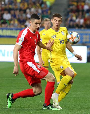 LVIV, UKRAINE - JUNE 7, 2019: Nikola Milenkovic of Serbia (L) fights for a ball with Vitaliy Mykolenko of Ukraine during their UEFA EURO 2020 Qualifying game at Arena Lviv stadium. Ukraine won 5-0