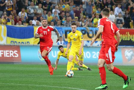 LVIV, UKRAINE - JUNE 7, 2019: Viktor Tsygankov of Ukraine (in Yellow) attacks during the UEFA EURO 2020 Qualifying game against Serbia at Arena Lviv stadium. Ukraine won 5-0. Tsygankov scored twice