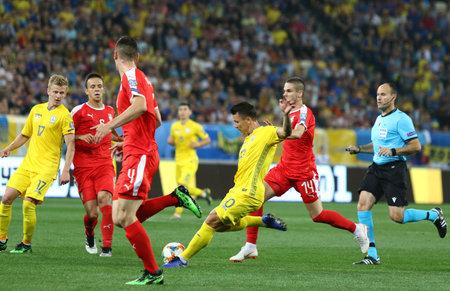 LVIV, UKRAINE - JUNE 7, 2019: Yevhen Konoplyanka of Ukraine (in Yellow) kicks a ball during the UEFA EURO 2020 Qualifying game against Serbia at Arena Lviv stadium in Lviv. Ukraine won 5-0