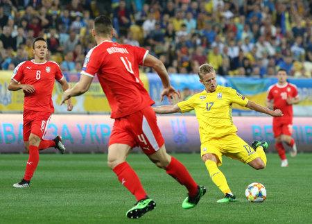 LVIV, UKRAINE - JUNE 7, 2019: Oleksandr Zinchenko of Ukraine kicks a ball during the UEFA EURO 2020 Qualifying game against Serbia at Arena Lviv stadium in Lviv. Ukraine won 5-0 Редакционное