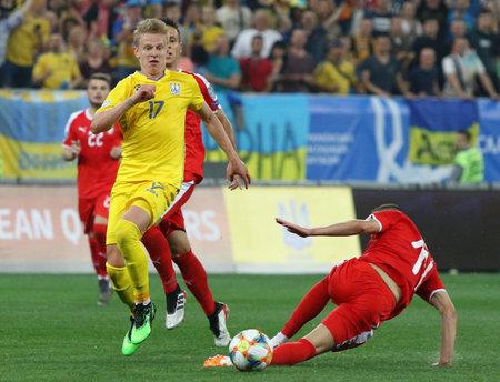 LVIV, UKRAINE - JUNE 7, 2019: Oleksandr Zinchenko of Ukraine (in Yellow) attacks during the UEFA EURO 2020 Qualifying game against Serbia at Arena Lviv stadium in Lviv. Ukraine won 5-0 Редакционное