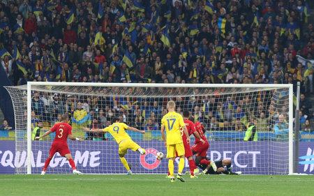 Kyiv, Ukraine - October 14, 2019: Roman Yaremchuk of Ukraine (#9) scores a goal during the UEFA EURO 2020 Qualifying game against Portugal at NSK Olimpiyskyi stadium in Kyiv. Ukraine won 2-1 新聞圖片
