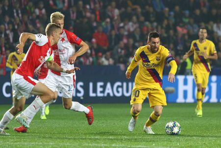 PRAGUE, CZECHIA - OCTOBER 23, 2019: Lionel Messi of Barcelona (R) controls a ball during the UEFA Champions League game against Slavia Praha at Eden Arena in Prague. Messi scored. Barcelona won 2-1
