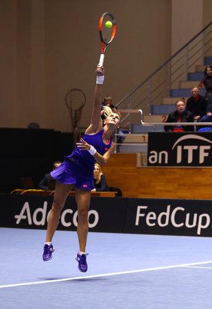 KHARKIV, UKRAINE - FEBRUARY 11, 2017: Lesia TSURENKO of Ukraine serves during BNP Paribas FedCup tennis game against Daria GAVRILOVA of Australia at Palace of Sports Lokomotiv in Kharkiv