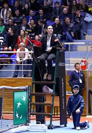 KHARKIV, UKRAINE - FEBRUARY 11, 2017: Chair umpire (tennis referee) on the position during the BNP Paribas FedCup tennis game Ukraine v Australia at Palace of Sports Lokomotiv in Kharkiv, Ukraine