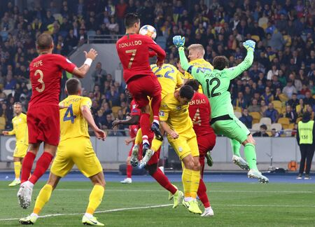 Kyiv, Ukraine - October 14, 2019: Ukrainian (in Yellow) and Portuguese (in Red) players fight for a ball during their UEFA EURO 2020 Qualifying game at NSK Olimpiyskyi stadium in Kyiv. Ukraine won 2-1