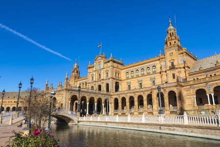 Building and river at the Spain Square (Plaza de Espana) in Seville (Sevilla) city, Andalusia, Spain.