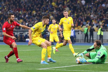 Kyiv, Ukraine - October 14, 2019: Goalkeeper Andriy Pyatov of Ukraine (R) in action during the UEFA EURO 2020 Qualifying game Ukraine v Portugal at NSK Olimpiyskyi stadium in Kyiv. Ukraine won 2-1