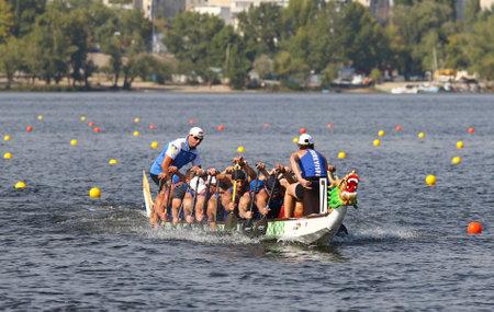 Kyiv, Ukraine - September 13, 2019: ICF Dragon Boat Club Crew World Championships 2019 on Dnipro river in Kyiv, Ukraine. D20 Senior Men 2000m Final, Team - DC Burevisnyk (Ukraine) Stockfoto - 134697472