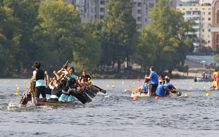 Kyiv, Ukraine - September 13, 2019: ICF Dragon Boat Club Crew World Championships 2019 on Dnipro river in Kyiv, Ukraine. D10 Junior Mixed 2000m Final, Team China Stockfoto - 134697480