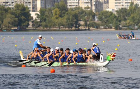 Kyiv, Ukraine - September 13, 2019: ICF Dragon Boat Club Crew World Championships 2019 on Dnipro river in Kyiv, Ukraine. D20 Senior Men 2000m Final, Team - DC Burevisnyk (Ukraine) Stockfoto - 134697488