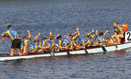 Kyiv, Ukraine - September 13, 2019: ICF Dragon Boat Club Crew World Championships 2019 on Dnipro river in Kyiv, Ukraine. D10 Junior Mixed 2000m Final, Team - DragonKom (Ukraine)