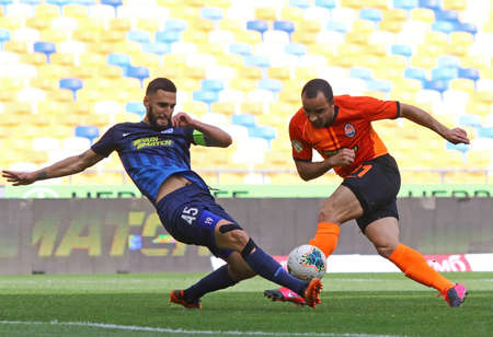 KYIV, UKRAINE - JUNE 6, 2020: Ismaily of Shakhtar Donetsk (R) fights for a ball with Denys Favorov of Desna Chernihiv during their Ukrainian Premier League game at NSC Olympiyskyi stadium in Kyiv