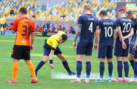 KYIV, UKRAINE - JUNE 6, 2020: Referee Serhiy Boyko uses a vanishing spray (vanishing foam) during the Ukrainian Premier League game Shakhtar Donetsk v Desna Chernihiv at NSC Olympiyskyi stadium
