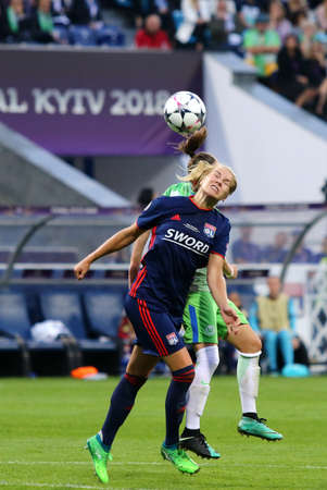 KYIV, UKRAINE - MAY 24, 2018: Ada Hegerberg of Olympique Lyonnais fights for a ball with VFL Wolfsburg player during their UEFA Women's Champions League Final 2018 game in Kyiv