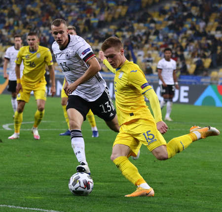KYIV, UKRAINE - OCTOBER 10, 2020: Viktor Tsygankov of Ukraine (R) controls a ball during the UEFA Nations League game against Germany at NSK Olimpiyskiy stadium in Kyiv. Germany won 2-1