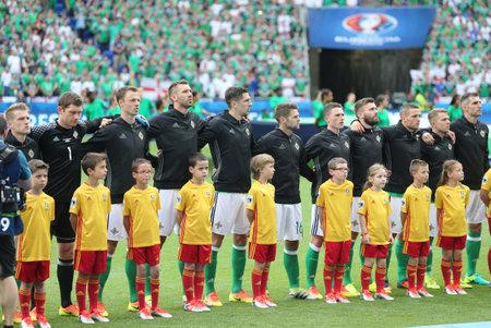 LYON, FRANCE - JUNE 16, 2016: Players of Northern Ireland national football team listen to national anthem before UEFA EURO 2016 game against Ukraine at Stade de Lyon stadium in Lyon