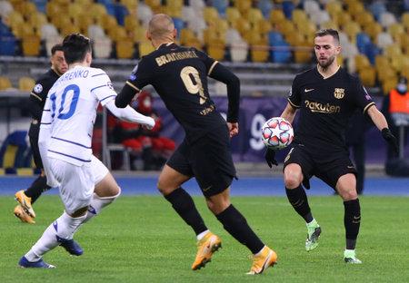 KYIV, UKRAINE - NOVEMBER 24, 2020: Jordi Alba of Barcelona (R) attacks during the UEFA Champions League game against Dynamo Kyiv at NSC Olimpiyskyi stadium in Kyiv. Barcelona won 4-0