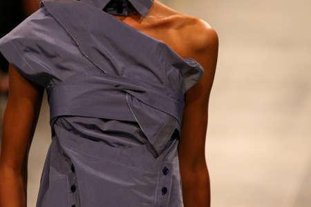 Fashion show. Catwalk event. Unrecognisable model. Close-up details of fashionable clothes