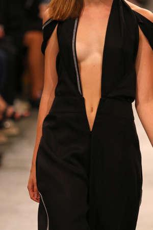 Fashion show. Unrecognisable model. Close-up details of fashionable clothes