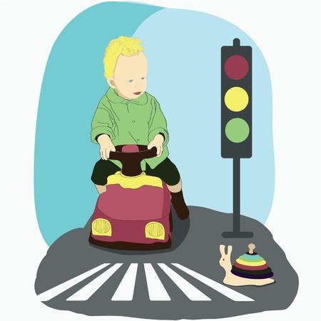 paso de cebra: Un ni�o peque�o en el coche de juguete