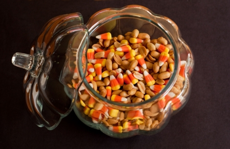 Pumkin candy dish filled with peanuts and candy corn