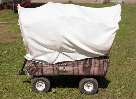 covered wagon: Childs red wagon turned into a covered wagon with room for copyspace