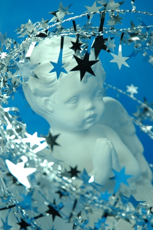 silvery: Praying white cherub surrounded by silvery stars