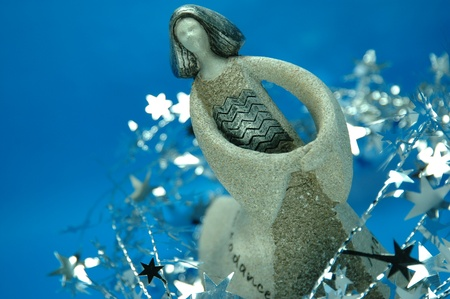 silvery: Dancing femal figurine with silvery stars Stock Photo