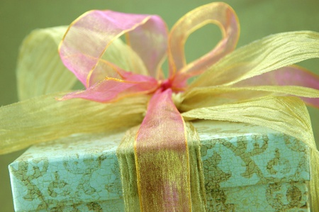 Close-up of gift box with pink and gold ribbon Stok Fotoğraf