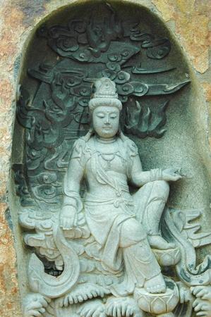 A stone staute of a spiritual figure