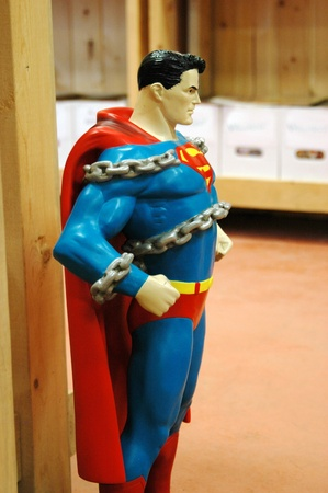 busting: A statue of superman busting out of chains  Editorial