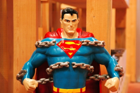 A statue of superman busting out of chains