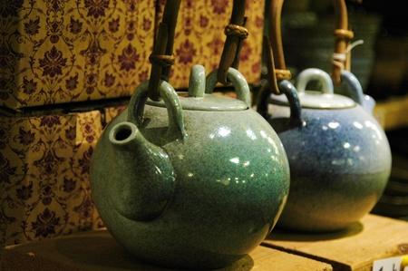 Two porcelian teapots in a shop